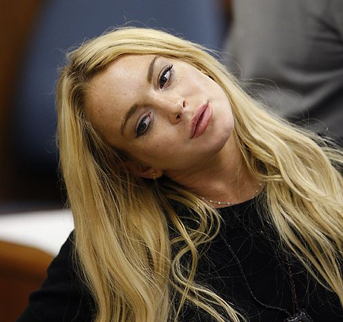 Actress Lindsay Lohan appears in court during a probation status hearing relating to her August 2007 no contest pleas to two counts each of DUI and being under the influence of cocaine, along with a reckless driving charge, at the Beverly Hills Municipal Courthouse, in Beverly Hills, California on July 6, 2010.      UPI/David McNew/Pool