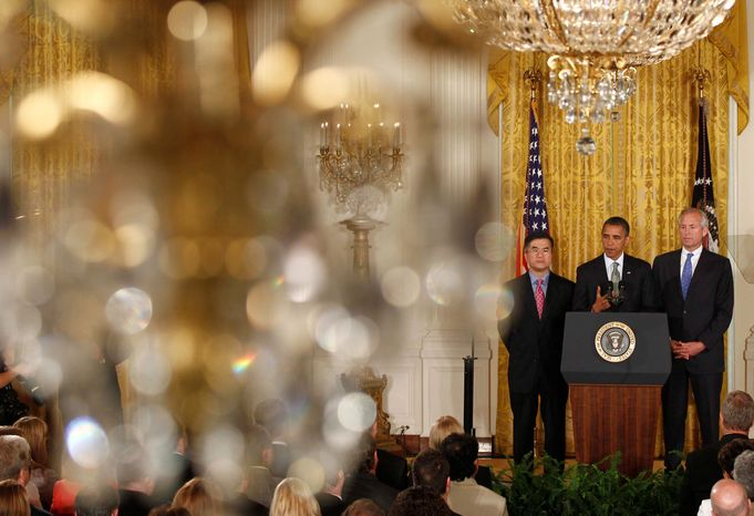 President Barack Obama stands with Boeing President, Chairman and CEO Jim McNerney, Jr., right, and Commerce Secretary Gary Locke, as he speaks about exports, jobs and the economy on Wednesday, July 7, 2010, in the East Room of the White House in Washington. (AP Photo/Charles Dharapak)