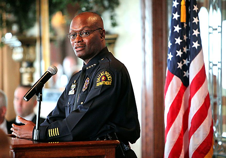 Dallas Police Chief David Brown speaks during a breakfast meeting Wednesday July 7, 2010 of the North Texas Crime Commission at the Park Cities Club, in Dallas. Brown is resuming his public duties more than two weeks after his son was killed. An autopsy found that David Brown Jr. had marijuana and PCP in his system when he fatally shot Lancaster police Officer Craig Shaw and neighbor Jeremy McMillan on June 20. The Father's Day shootings took place during a domestic dispute at an apartment complex. Officers returned fire and killed Brown Jr. (AP Photo/The Dallas Morning News, Jim Mahoney)