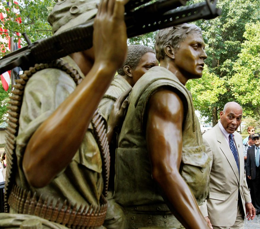 """Associated Press Retired Army Brig. Gen. George Price looks at the """"Three Servicemen"""" statue at the Vietnam Veterans Memorial in Washington. It was unveiled Thursday following six weeks of restoration."""
