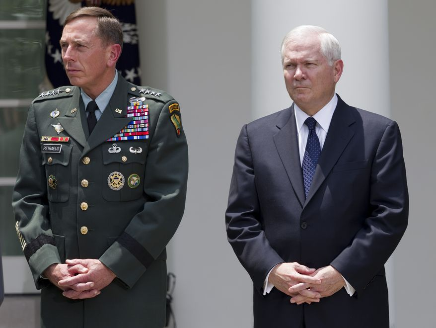 Gen. David Petraeus, left, and Defense Secretary Robert Gates look on as President Obama announces that Gen. Petraeus will replace Gen. Stanley McChrystal as the top commander in Afghanistan, Wednesday, June 23, 2010, in the Rose Garden of the White House in Washington. On Thursday, July 8, 2010, Mr. Gates said Marine Corps Gen. James Mattis will replace Gen. Petraeus at the U.S. Central Command. (AP Photo/Evan Vucci)