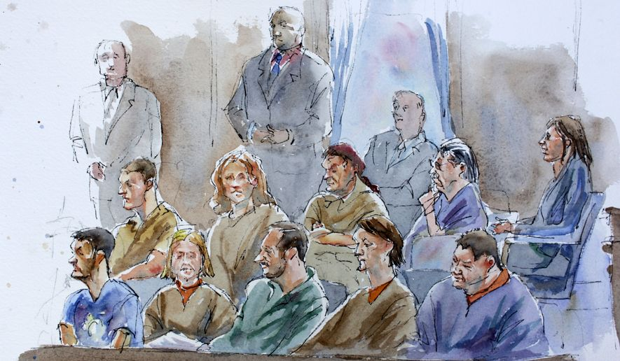 This courtroom sketch shows, bottom row from right, Richard Murphy, Cynthia Murphy, Donald Howard Heathfield, Tracey Lee Ann Foley, Michael Zottoli, top row from right, Patricia Mills, Juan Lazaro, Vicky Pelaez, Anna Chapman, and Mikhail Semenko during their arraignment in in Manhattan federal court Thursday, July 8, 2010 in New York. A spy swap between the U.S. and Russia is unfolding as 10 people accused of spying in suburban America have pleaded guilty to conspiracy and have been ordered deported to Russia in exchange for the release of four Russian spies. (AP Photo/Aggie Kenny)