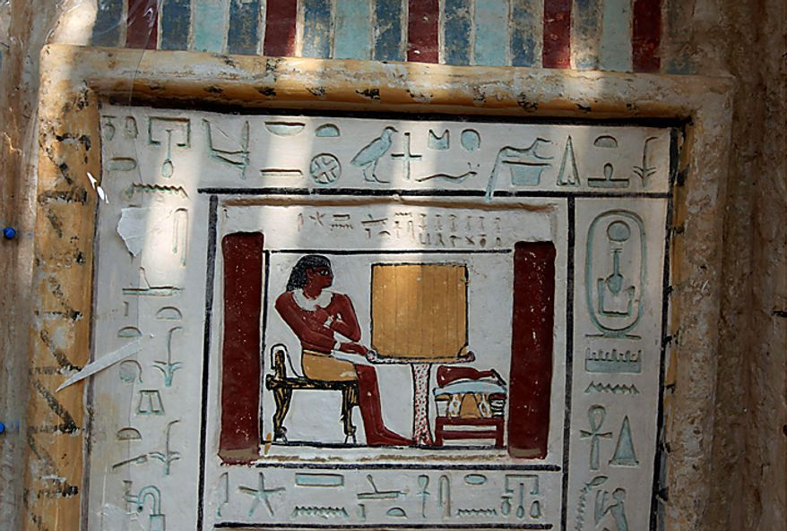 The false door of the unearthed tomb of Shendwas, father of Khonsu, both of whom served as heads of the royal scribes during the Old Kingdom, is decorated with a painting depicting the owner sitting at a sacrifice table, in Saqqara near Cairo, Egypt, Thursday, July 8, 2010. (AP Photo/Nasser Nasser)