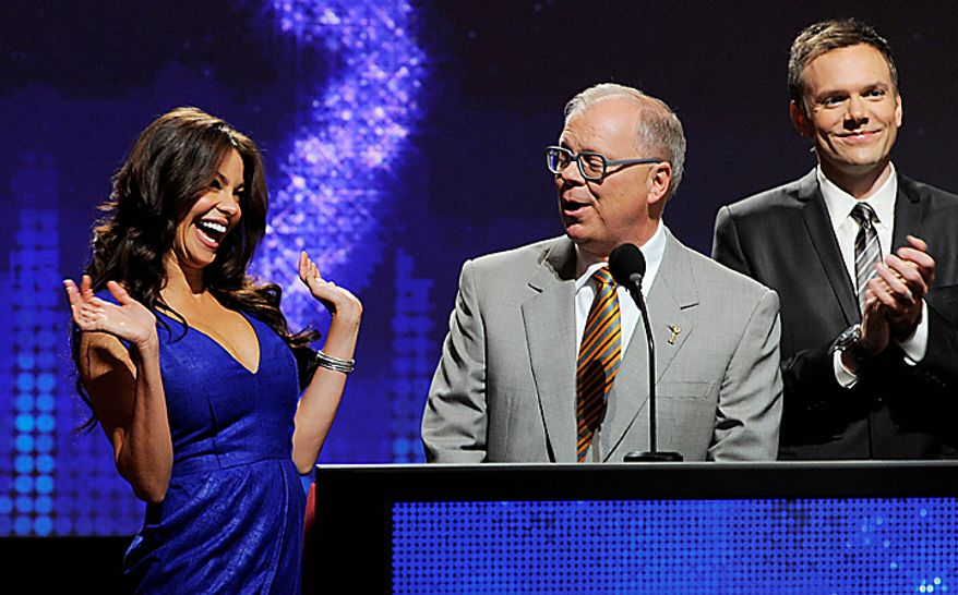 "Presenter Sofia Vergara, left, reacts alongside Television Academy Chairman and CEO John Shaffner, center, and actor Joel McHale after she received an Emmy nomination for Outstanding Supporting Actress in a Comedy Series for ""Modern Family,"" during nominations for the 62nd Primetime Emmy Awards at the Academy of Television Arts & Sciences in Los Angeles, Thursday, July 8, 2010. The show will be held on Aug. 29 at the Nokia Theatre in Los Angeles. (AP Photo/Chris Pizzello)"