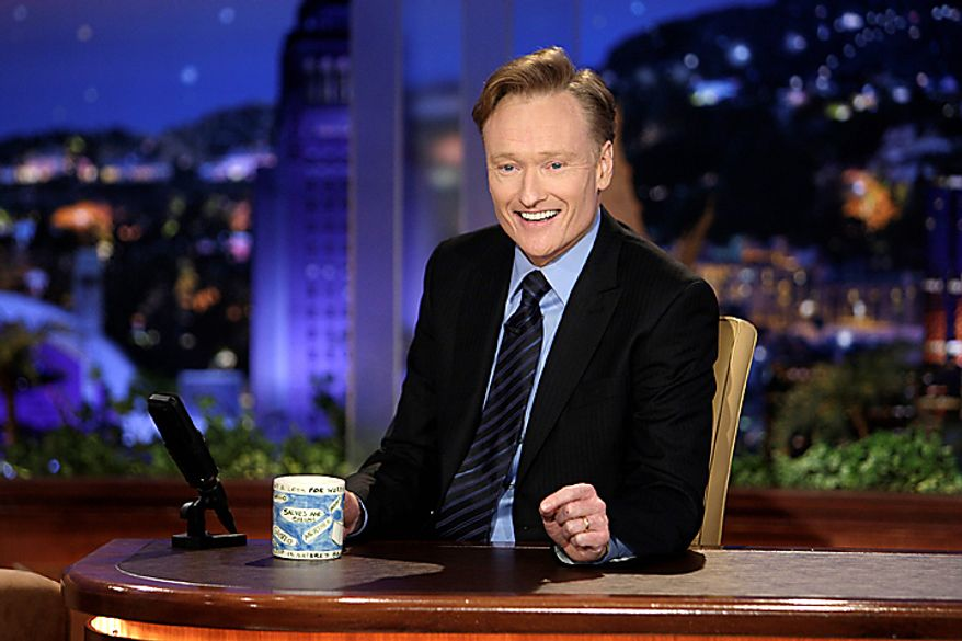 """In this June 1, 2009, file photo provided by NBC, Conan O'Brien makes his debut as the host of NBC's """"The Tonight Show"""" in Universal City, Calif. O'Brien was nominated for an Emmy for outstanding variety, music or comedy series on Thursday, July 8, 2010, for his work on """"The Tonight Show with Conan O'Brien."""" The 62nd Primetime Emmy Awards will be held on Sunday, Aug. 29, in Los Angeles. (AP Photo/NBC, Paul Drinkwater)"""