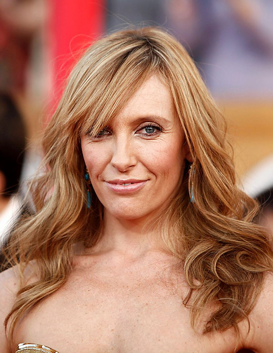 "In this Jan. 23, 2010, file photo, actress Toni Collette arrives at the 16th Annual Screen Actors Guild Awards in Los Angeles. Collette was nominated for an Emmy on Thursday, July 8, 2010, for lead actress in a comedy series for her role in ""United States of Tara."" The 62nd Primetime Emmy Awards will be held on Sunday, Aug. 29. (AP Photo/Matt Sayles, file)"