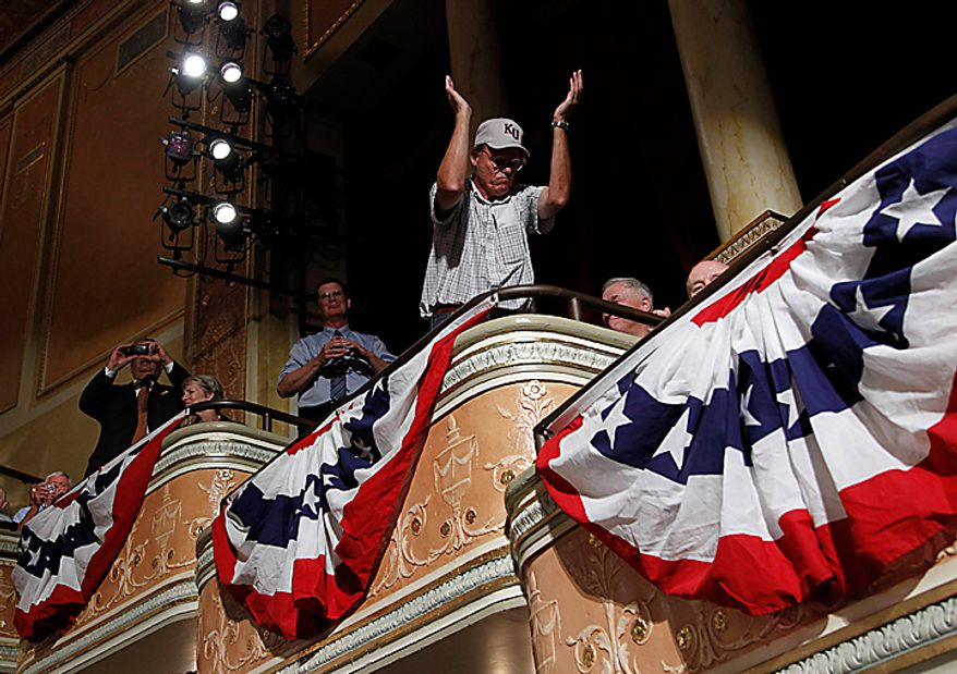 A supporter stands up to applaud during the introduction of President Barack Obama at a campaign fundraiser for Missouri Senate hopeful Robin Carnahan, Thursday, July 8, 2010, in Kansas City, Mo. (AP Photo/Pablo Martinez Monsivais)