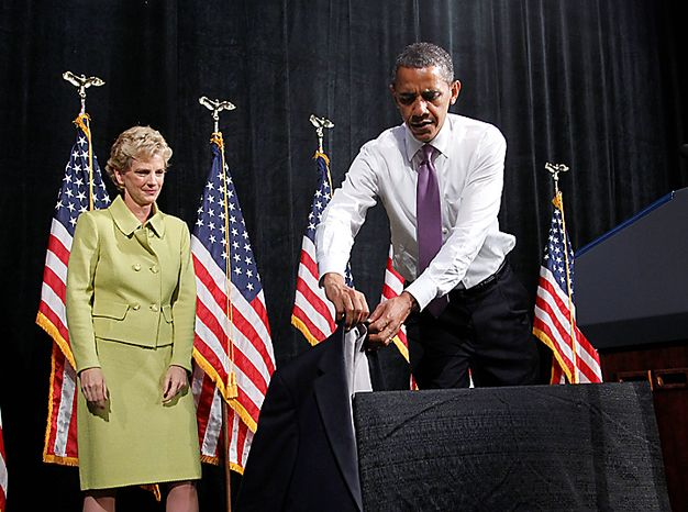 President Barack Obama takes off his suit jacket during a campaign rally for Missouri Senate hopeful Robin Carnahan, Thursday, July 8, 2010, in Kansas City, Mo. (AP Photo/Pablo Martinez Monsivais)