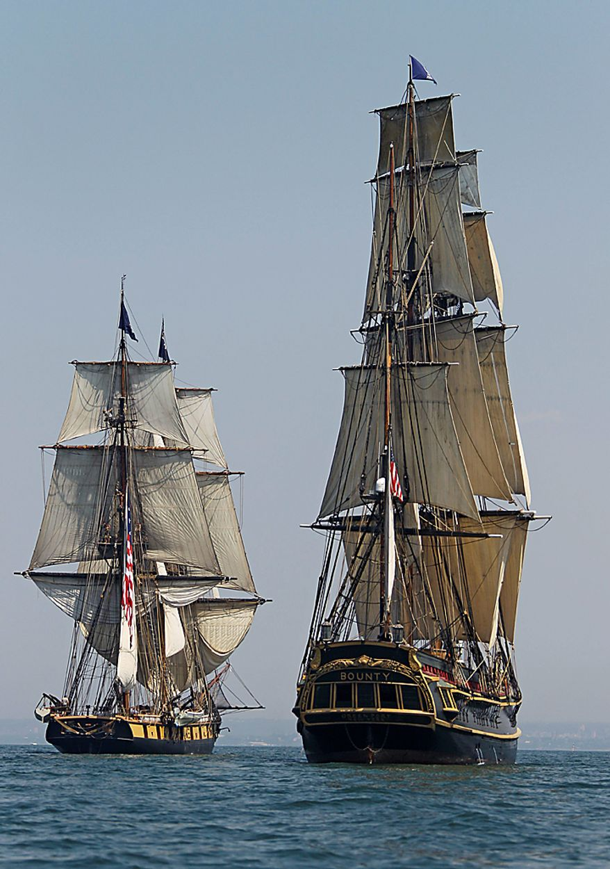 The HMS Bounty, right, and USS Niagara sail the waters of Lake Erie off Cleveland Wednesday, July 7, 2010. Eleven sailing ships will be in the city for the annual tall ships festival. (AP Photo/Mark Duncan)