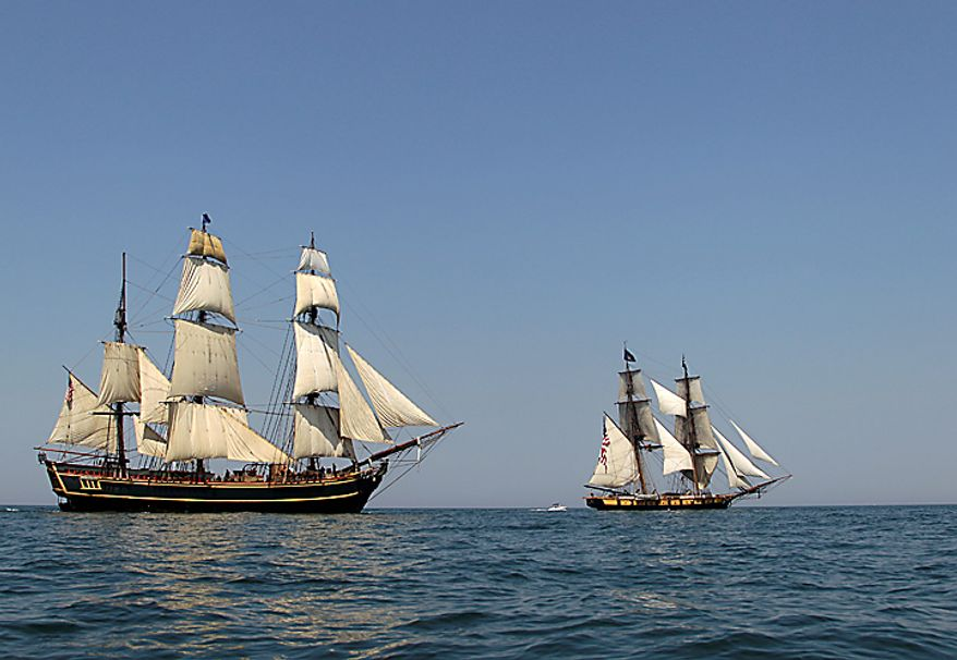 The HMS Bounty, left, and USS Niagara sail the waters of Lake Erie off Cleveland Wednesday, July 7, 2010. Eleven sailing ships will be in the city for the annual tall ships festival. (AP Photo/Mark Duncan)