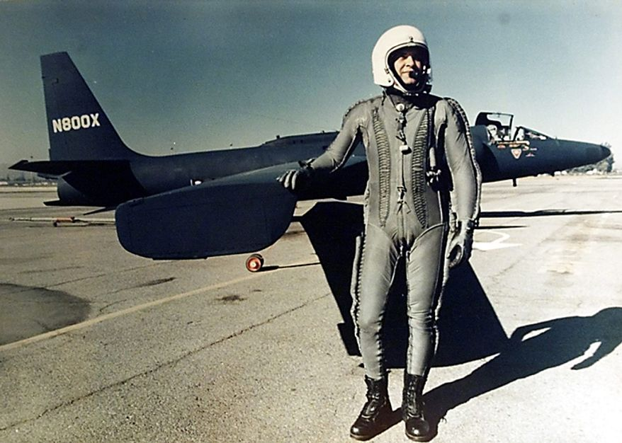 This undated file photo from an exhibition on the legendary U.S. pilot Francis Gary Powers at the Berlin Allied Museum in 2000, shows Powers standing in front of a U-2 photo reconnaissance plane. Powers and Rudolf Ivanovich Abel were released from their prison terms for espionage and were exchanged secretly at the border between West Berlin and East Germany on Feb. 10, 1962. (AP Photo/Allied Museum, File)
