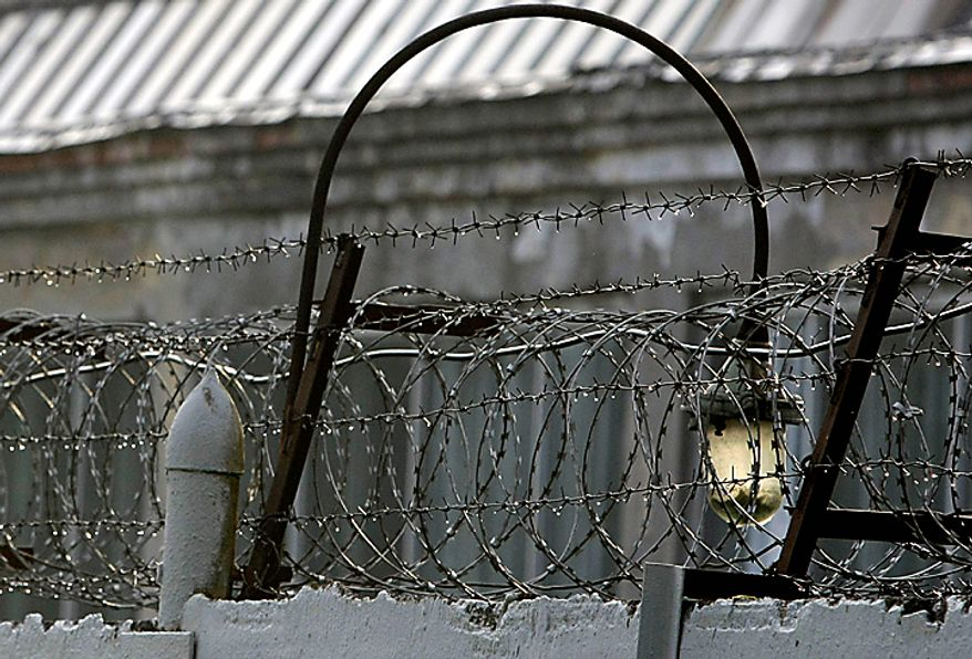 A barbed wire is seen over a fence of the Lefortovo prison in Moscow, Thursday, July 8, 2010.  Riot police on Thursday secured the perimeter of the prison, and convoy of armored vehicles arrived in the morning at the prison, thought to be the central gathering point for people convicted of spying for the West, including nuclear researcher Igor Sutyagin, serving a 14-year sentence for spying for the United States. (AP Photo/Misha Japaridze)(AP Photo/Misha Japaridze)