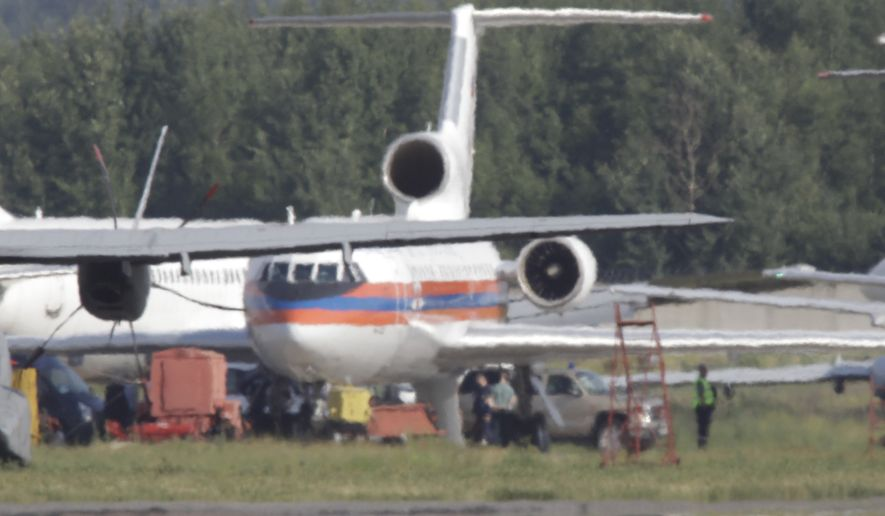 Russian plane believed to be carrying candidates for a 14-person spy swap, is seen at Moscow's Domodedovo airport, on Friday, July 9, 2010. The plane carrying the colours of the Russian Ministry of Emergency Situations is thought to have flown from Austria on Friday, following an exchange of spies between Moscow and Washington. (AP Photo/Sergey Ponomarev)