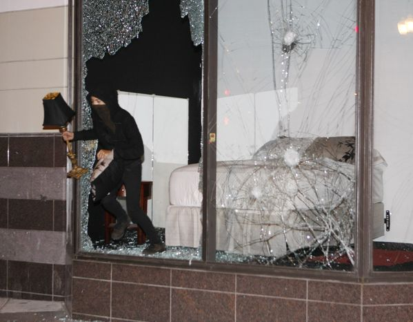 A demonstrator carries a lamp after the window was broken at Sears during a protest in Oakland, Calif., after a guilty verdict for Johannes Mehserle, Thursday, July 8, 2010. Former San Francisco Bay Area Rapid Transit police officer Johannes Mehserle was found guilty of involluntary manslaughter in Los Angeles for shooting unarmed black man Oscar Grant on New Year's Day 2009 at a BART station in Oakland. (AP Photo/Paul Sakuma)