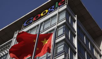 **FILE** A Chinese flag flutters outside Google's China headquarters in Beijing on Jan. 13, 2010. (Associated Press)