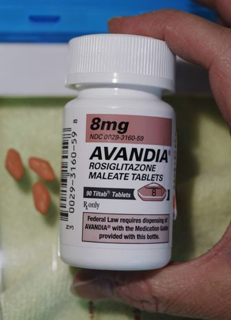 A pharmacist holds a bottle of Avandia pills at Maximart Pharmacy in Palo Alto, Calif., on Wednesday, June 30, 2010. (AP Photo/Paul Sakuma)