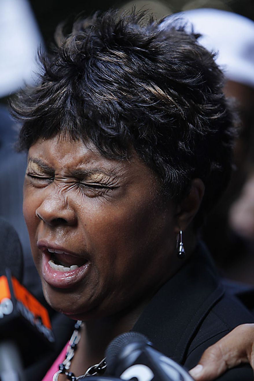 Wanda Johnson, mother of shooting victim Oscar Grant, prays for justice outside the Los Angeles Criminal Courts building after a jury found former BART police officer Johannes Mehserle guilty of involuntary manslaughter Thursday, July 8, 2010, in downtown Los Angeles. Mehserle, a former BART police officer, shot and killed Oscar Grant while he laid on his stomach on an Oakland, Calif. train platform. (AP Photo/Damian Dovarganes)
