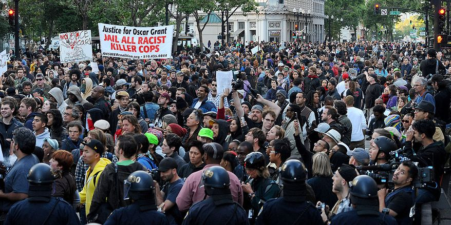 Protesters gather in Oakland, Calif., following an involuntary manslaughter verdict in Johannes Mehserle's trial on Thursday, July 8, 2010. A former transit police officer, Mehserle shot and killed unarmed black man Oscar Grant on New Year's Day 2009.  (AP Photo/Noah Berger)