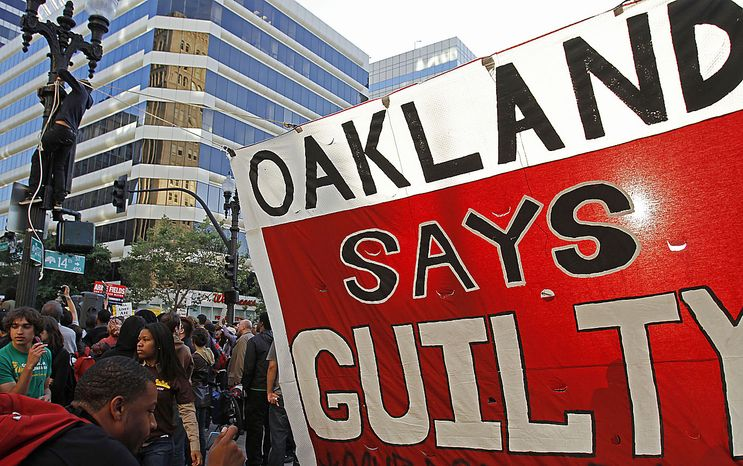 A crowd gathers in downtown Oakland to protest the verdict of involuntary manslaughter given to Johannes Mehserle Thursday, July 8, 2010, in Oakland, Calif. Former Bay Area Rapid Transit police officer Johannes Mehserle was found guilty in Los Angeles for shooting unarmed black man Oscar Grant on New Year's Day 2009 at a BART station in Oakland. (AP Photo/Ben Margot)