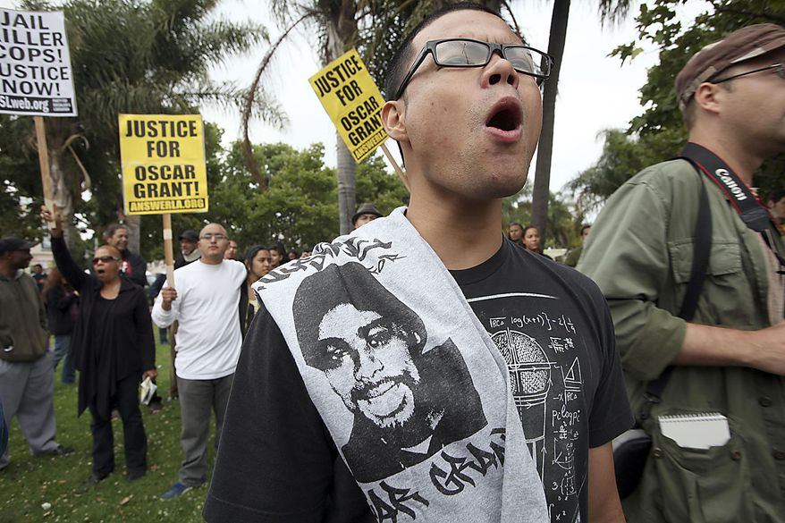 Jay Eusantos joins others during a demonstration protesting Johannes Mehserle's involuntary manslaughter conviction Thursday, July 8, 2010 in Los Angeles. Mehserle was on trial for murder in the shooting death of an unarmed black man on an Oakland train platform in a 2009 encounter that set off days of rioting in the city. (AP Photo/Nick Ut)