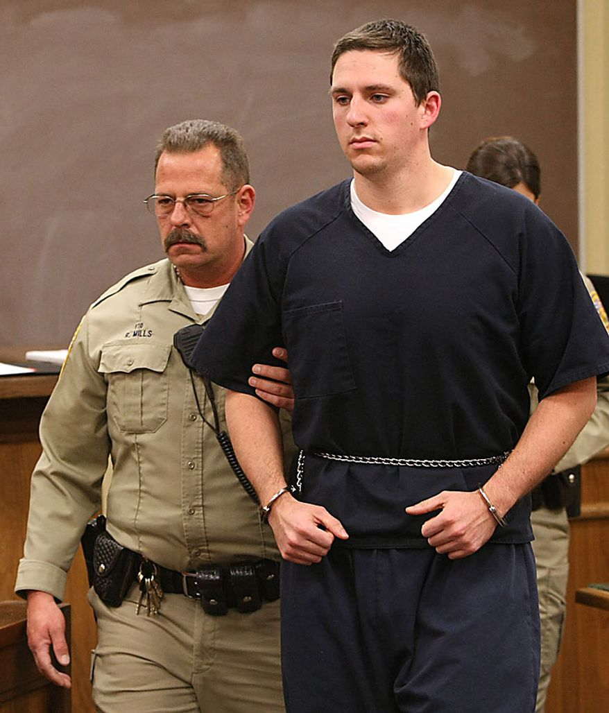 This Jan 14, 2009, file photo shows Johannes Mehserle, right, in the East Fork Justice Court in Minden, Nev. A jury reached a verdict Thursday, July 8, 2010, in  Mehserle's trial, a former San Francisco Bay area transit officer accused of murdering an unarmed black man on an Oakland train platform. The eight woman, four-man panel is scheduled to read the verdict at 4 p.m. PDT. (AP Photo/Cathleen Allison, file)