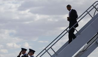President Barack Obama walks down the stairs during his arrival at McCarran International Airport in Las Vegas, Thursday, July 8, 2010.(AP Photo/Pablo Martinez Monsivais)