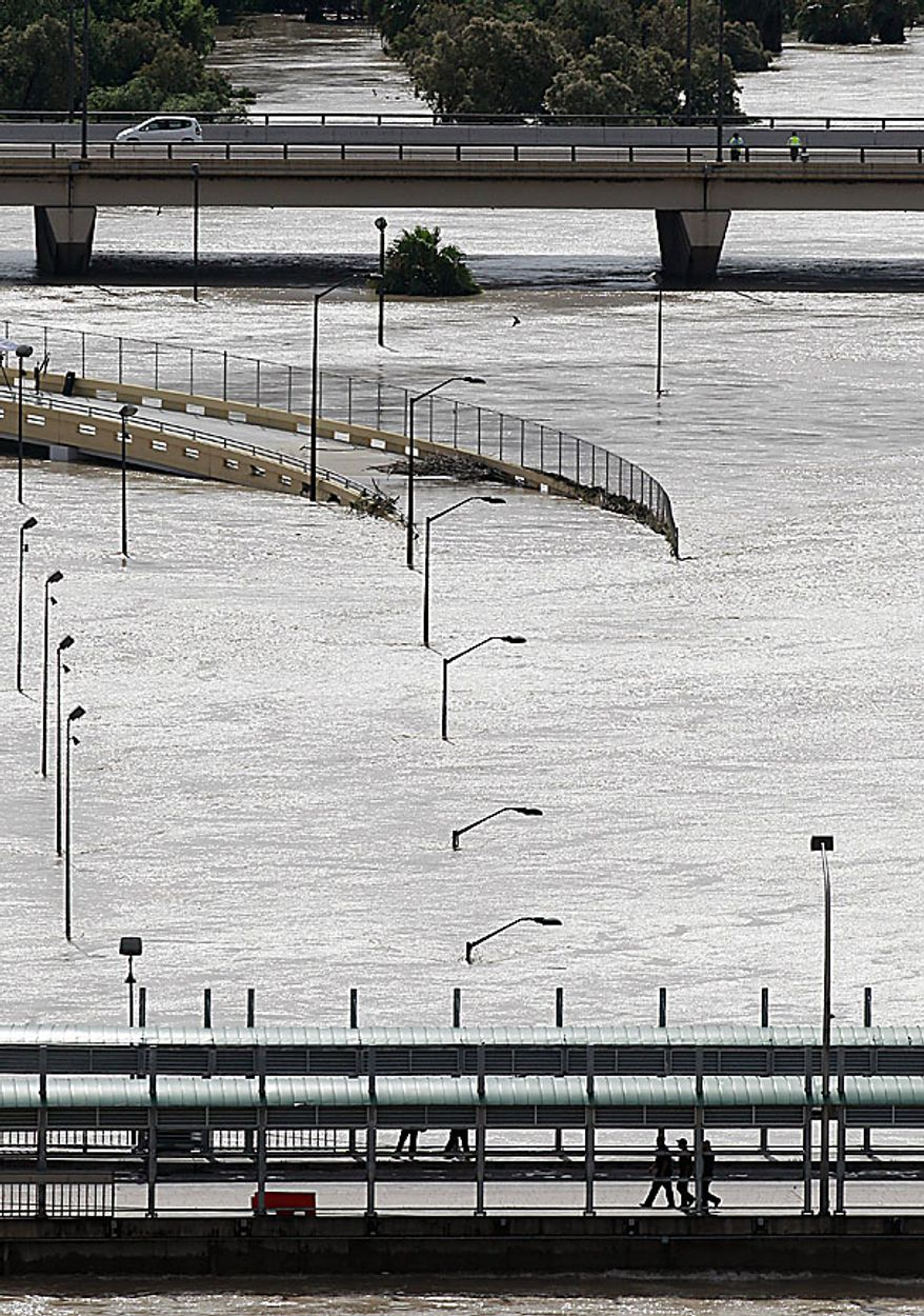 A swollen Rio Grande, driven by dam releases upstream and rain-swollen tributaries following last week's Hurricane Alex, pushes against International Bridge 1, which remains closed, and International Bridge 2, in the back, still open, Friday, July 9, 2010, in Laredo, Texas. The river has crested, but is not expected to drop for several days. (AP Photo/Eric Gay)