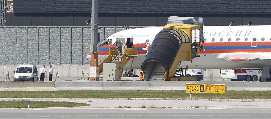 A  Russian plane believed to be carrying candidates for a 14-person spy swap as part of the largest spy swap since the Cold War is parked on the tarmac at Vienna's Schwechat airport on Friday, July 9, 2010. (AP Photo/Matthias Schrader)
