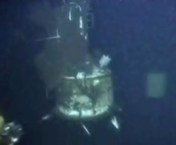 In this image taken from video provided by BP PLC, the containment cap that had previously been covering the well head at the Deepwater Horizon oil spill site, in the Gulf of Mexico, is lifted above the gushing leak on Saturday, July 10, 2010. Officials say a tighter dome will be installed to funnel more oil to collection ships on the surface a mile above. (AP Photo/BP PLC)