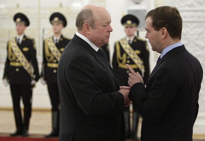 In this Dec. 15, 2009, file photo, Russian President Dmitry Medvedev and Russian Foreign Intelligence Service Chief Mikhail Fradkov, left, talk during a Foreign intelligence Service flag presentation ceremony in Moscow. Less than two weeks after the FBI broke the spy ring in a counterintelligence operation cultivated for a decade, 10 Russian secret agents caught in the U.S. are back in Russia
