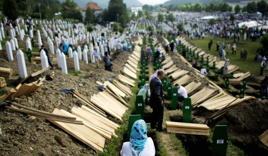 Thousands gathered in Srebrenica to bury hundreds of massacre victims on the 15th anniversary of the worst atrocity in Europe since the Nazi era. (Associated Press)