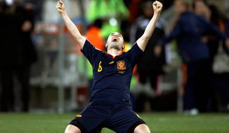 Spain's Andres Iniesta celebrates after scoring the game-winning goal during the World Cup final at Soccer City in Johannesburg on Sunday. Spain grabbed its first World Cup title. (Associated Press)
