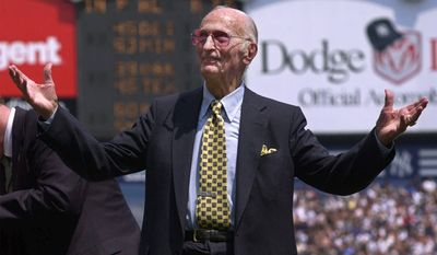 """ASSOCIATED PRESS FILE - In this May 7, 2000 file photo, New York Yankees public address announcer Bob Sheppard acknowledges the cheers of the fans at Yankee Stadium in New York. The New York Yankees say longtime public address announcer Bob Sheppard has died. His death was confirmed to The Associated Press on Sunday, July 11, 2010 by team spokesman Jason Zillo. Sheppard started with the Yankees in 1951. His impeccable introductions of stars from Joe DiMaggio to Derek Jeter earned him the nickname """"The Voice of God."""""""