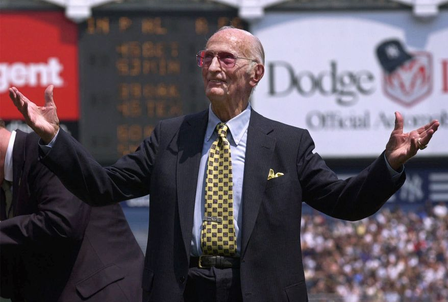 "ASSOCIATED PRESS FILE - In this May 7, 2000 file photo, New York Yankees public address announcer Bob Sheppard acknowledges the cheers of the fans at Yankee Stadium in New York. The New York Yankees say longtime public address announcer Bob Sheppard has died. His death was confirmed to The Associated Press on Sunday, July 11, 2010 by team spokesman Jason Zillo. Sheppard started with the Yankees in 1951. His impeccable introductions of stars from Joe DiMaggio to Derek Jeter earned him the nickname ""The Voice of God."""