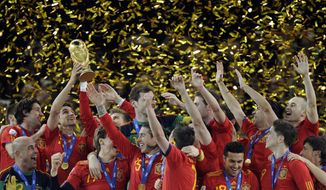ASSOCIATED PRESS Spain players celebrate with the World Cup trophy at the end of the World Cup final soccer match between the Netherlands and Spain at Soccer City in Johannesburg, South Africa, Sunday, July 11, 2010. Spain won 1-0.