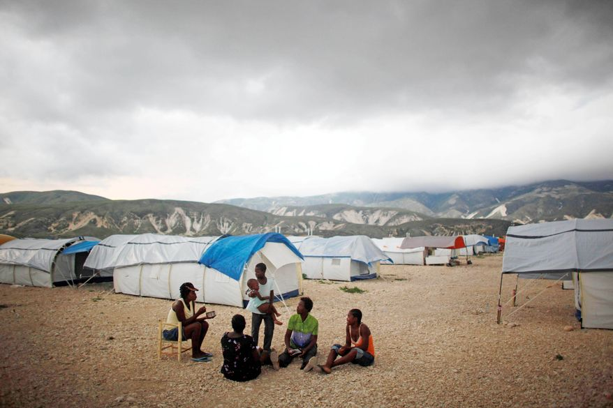 Makeshift slums have sprung up near Corail-Cesselesse, located between the barren mountains and sea north of Port-au-Prince, by people seeking refuge from overflowing camps in the city. (Associated Press)