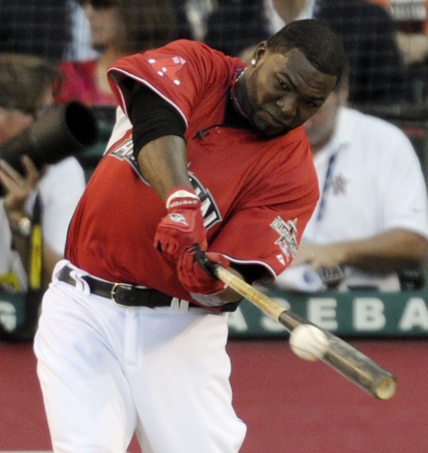 ASSOCIATED PRESS Boston Red Sox's David Ortiz hits a home run during baseball's All-Star home run derby Monday, July 12, 2010, in Anaheim, Calif.