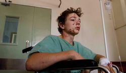 """Thomas Kramer is one of the five U.S. citizens who were injured in a bomb blast Sunday in an Ethiopian restaurant in Kampala. """"I never thought that could happen to me"""" said the 14-year-old from Pennsylvania, who went to Uganda with his mother and her church. (Associated Press)"""