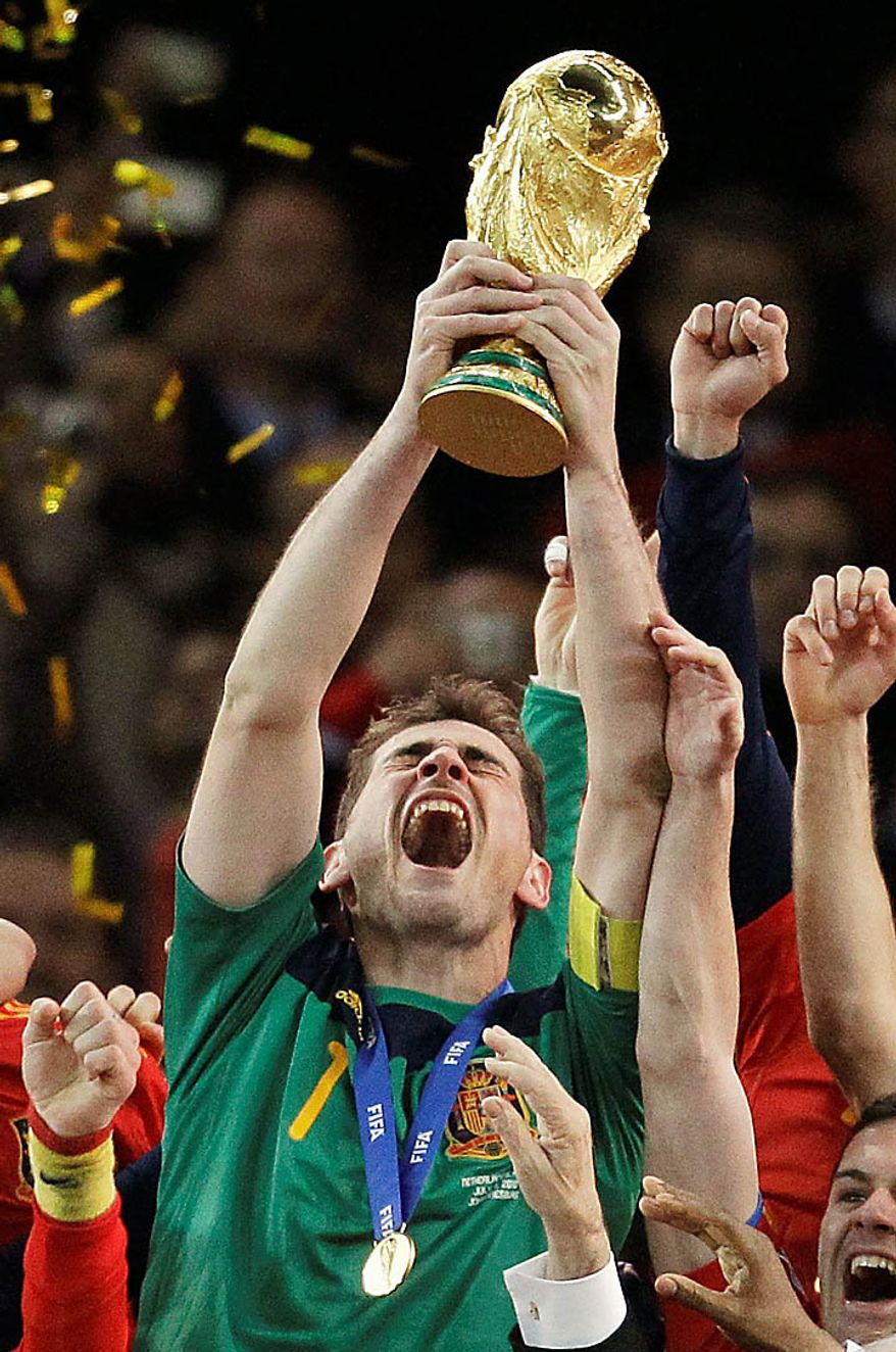 Spain goalkeeper Iker Casillas holds up the World Cup trophy following the World Cup final soccer match between the Netherlands and Spain at Soccer City in Johannesburg, South Africa, Sunday, July 11, 2010. Spain won 1-0. (AP Photo/Matt Dunham)