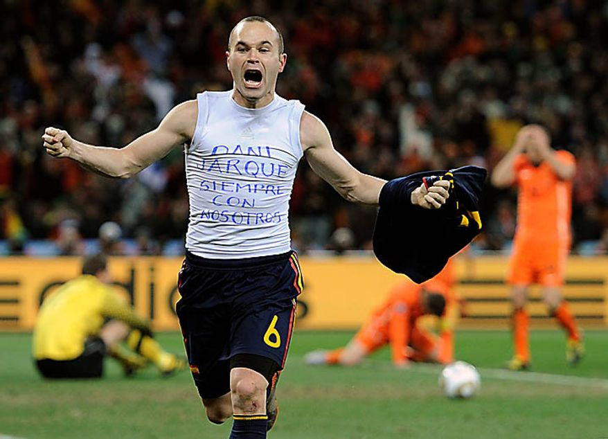 """Spain's Andres Iniesta celebrates after scoring a goal, with the words """"Dani Jarque, always with us,"""" written on his undershirt during the World Cup final soccer match between the Netherlands and Spain at Soccer City in Johannesburg, South Africa, Sunday, July 11, 2010. (AP Photo/Martin Meissner)"""