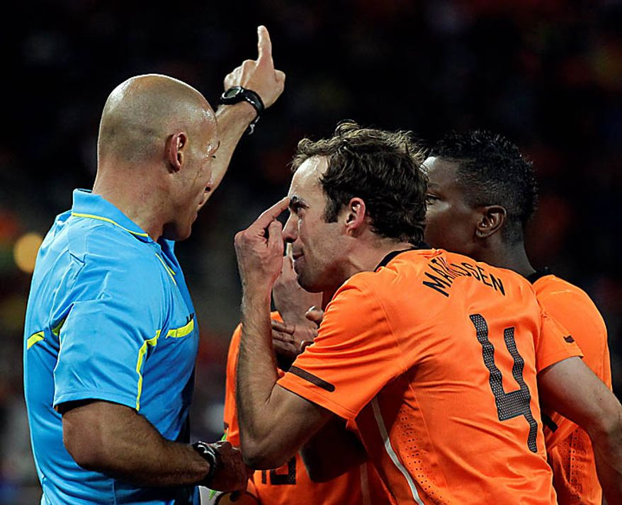 Netherlands' Joris Mathijsen, number 4, faces English referee Howard Webb during the World Cup final soccer match between the Netherlands and Spain at Soccer City in Johannesburg, South Africa, Sunday, July 11, 2010. Spain won 1-0 and clinched the World Cup. (AP Photo/Matt Dunham)