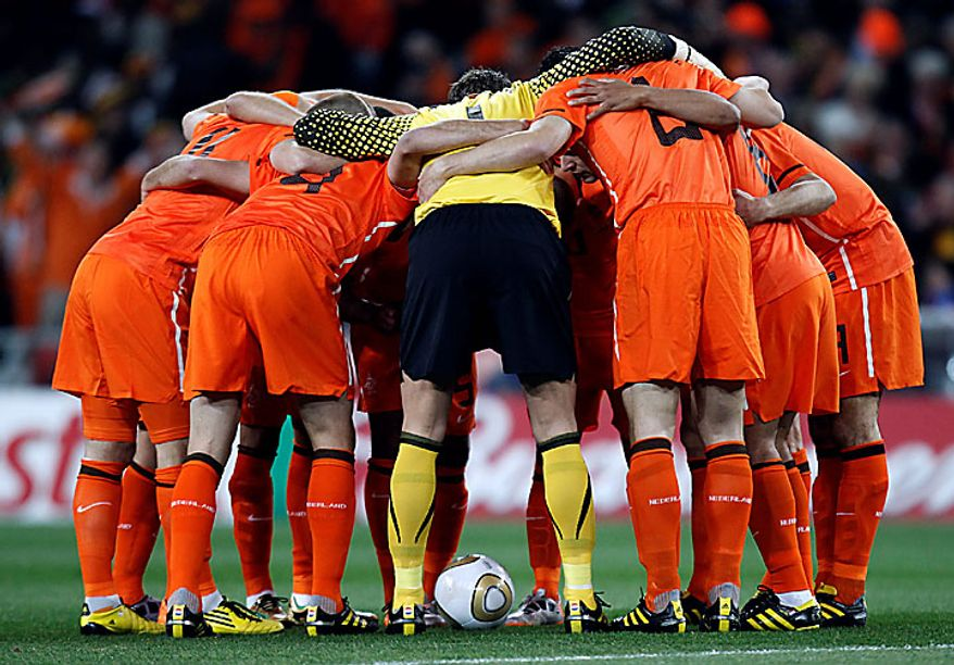 The Dutch team gathers prior to the World Cup final soccer match between the Netherlands and Spain at Soccer City in Johannesburg, South Africa, Sunday, July 11, 2010. (AP Photo/Luca Bruno)