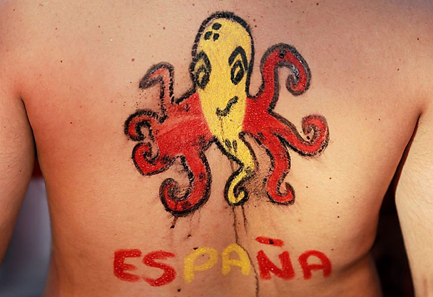 A Spanish fan displays a body painting of octopus oracle, Paul, on his back in Madrid before the start of the World Cup soccer final between Spain and the Netherlands in South Africa on Sunday, July 11, 2010. (AP Photo/Armando Franca)