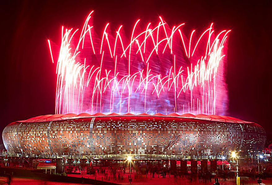 Fireworks are seen over Soccer City stadium after the World Cup final soccer match between the Netherlands and Spain at Soccer City in Johannesburg, South Africa, on Sunday, July 11, 2010. Spain won its first world title after beating the Netherlands 1-0. (AP Photo/Gero Breloer)