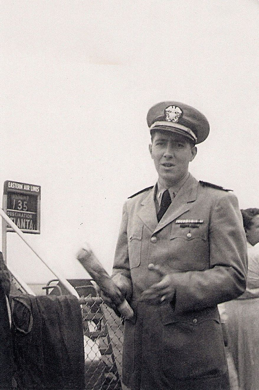 This undated photo provided by the family shows Ensign Robert Langwell, whose remains were missing since the Korean War. He was laid to rest in Arlington National Cemetery on Monday, 60 years after he drowned off the coast of Korea. (AP Photo/Langwell Family)