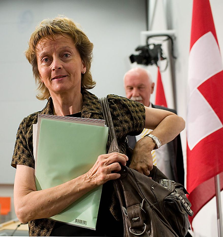 Swiss Cabinet-level Minister Eveline Widmer-Schlumpf leaves a press conference in Bern, Switzerland, on Monday, July 12, 2010, during which she said film director Roman Polanski will be a free man after the Swiss government rejected a U.S. request to extradite him on a charge of having sex in 1977 with a 13-year-old girl. (AP Photo/Anja Niedringhaus )