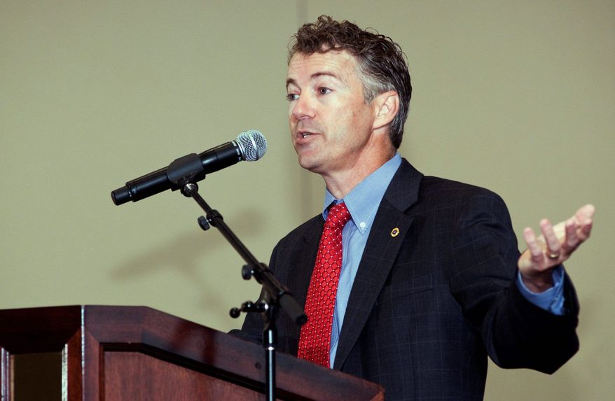 Republican U.S. Senate candidate Rand Paul spars with his Democratic opponent, Attorney General Jack Conway, at a gathering of county officials on July 8, 2010 in Louisville, Ky. The two are competing to replace Republican Sen. Jim Bunning, who is retiring after two terms. (Associated Press)