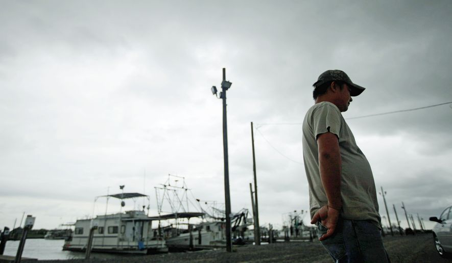 A Vietnamese oyster fisherman stands idle at the docks in Empire, La. The BP PLC oil spill has struck at the heart of the tight-knit Vietnamese community, posing hardships for those who brought their fishing traditions here as refugees. (Associated Press)