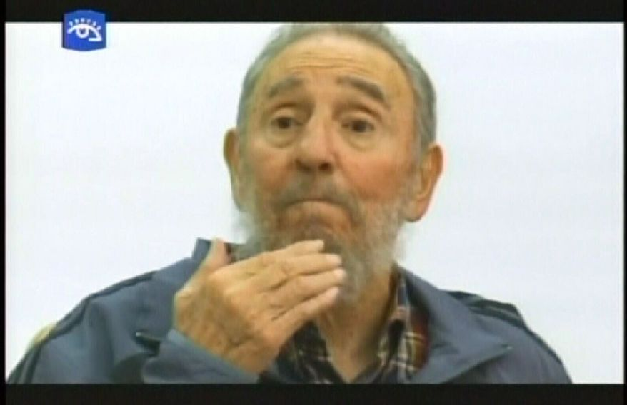 """This television image provided by Cubavision shows former Cuban president Fidel Castro speaking during an interview in Havana on Monday, July 12, 2010, on the """"Mesa Redonda"""" -- or """"Round Table"""" -- a daily Cuban talk show on current events. It was a rare appearance for Mr. Castro, who has stayed largely out of the public eye since a serious illness four years ago forced him from power. (AP Photo/APTN via Cubavision)"""