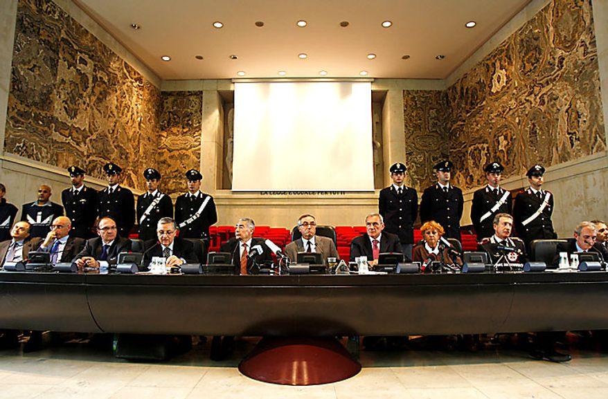 A view of a press conference at the Milan's court, Italy, Tuesday, July 13, 2010, following the biggest operations ever against the powerful 'ndrangheta crime organization, in which 300 people were arrested including top bosses, and million of dollars (euros) in property seized. The pre-dawn raids Tuesday involved some 3,000 police across the country. Charges include murder, extortion, arms and drug trafficking and criminal association. Investigators described the operation as one of biggest blows ever to an organization that today is considered more powerful than the Sicilian Mafia. (AP Photo/Antonio Calanni)